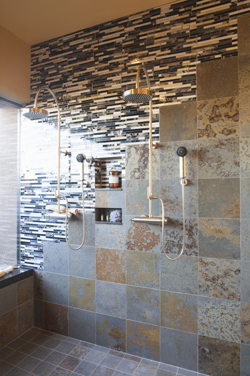 103585003-contrasting-tiles-in-wet-room-with-double-shower-headjpg