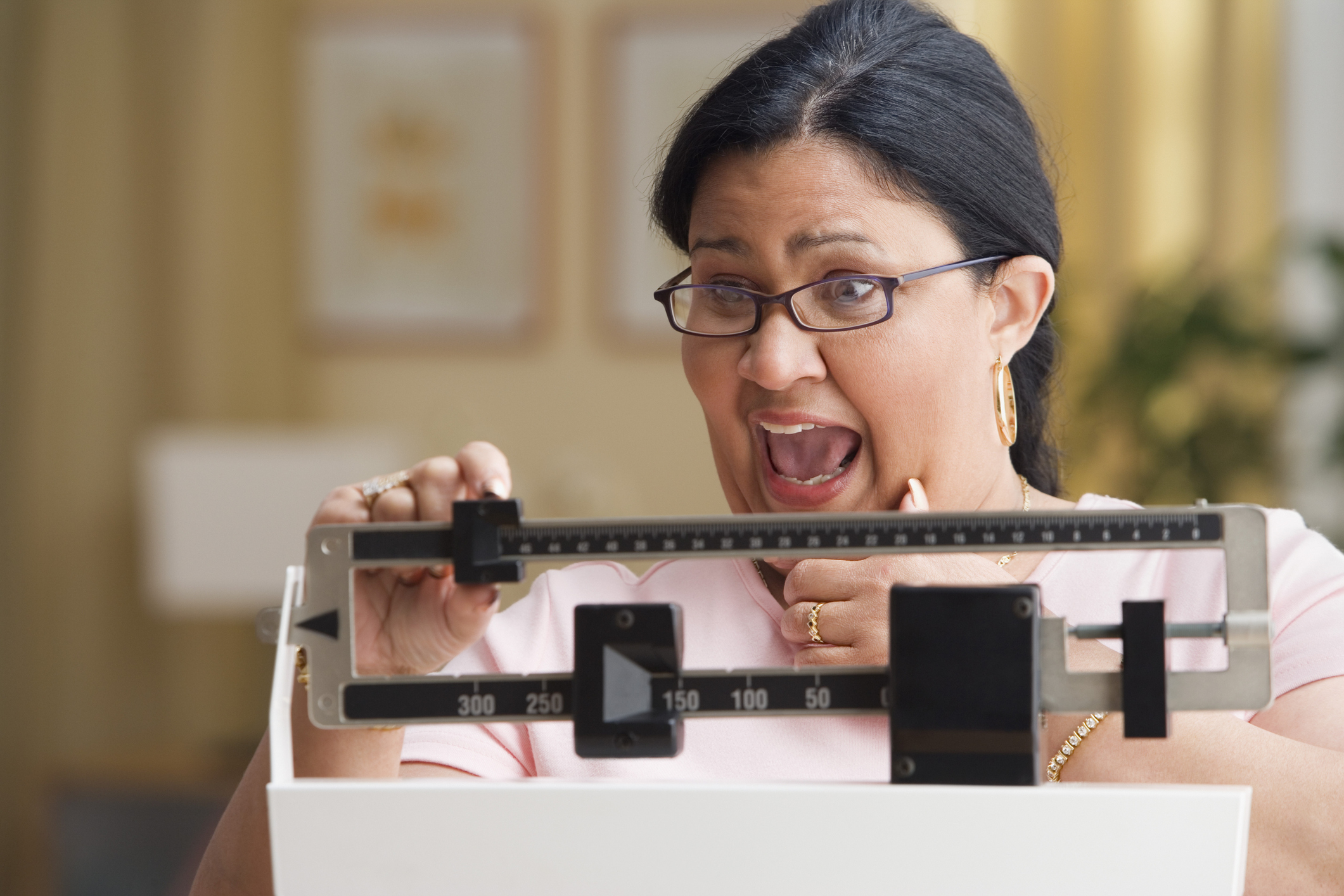 57532913-shocked-woman-weighing-herselfjpg