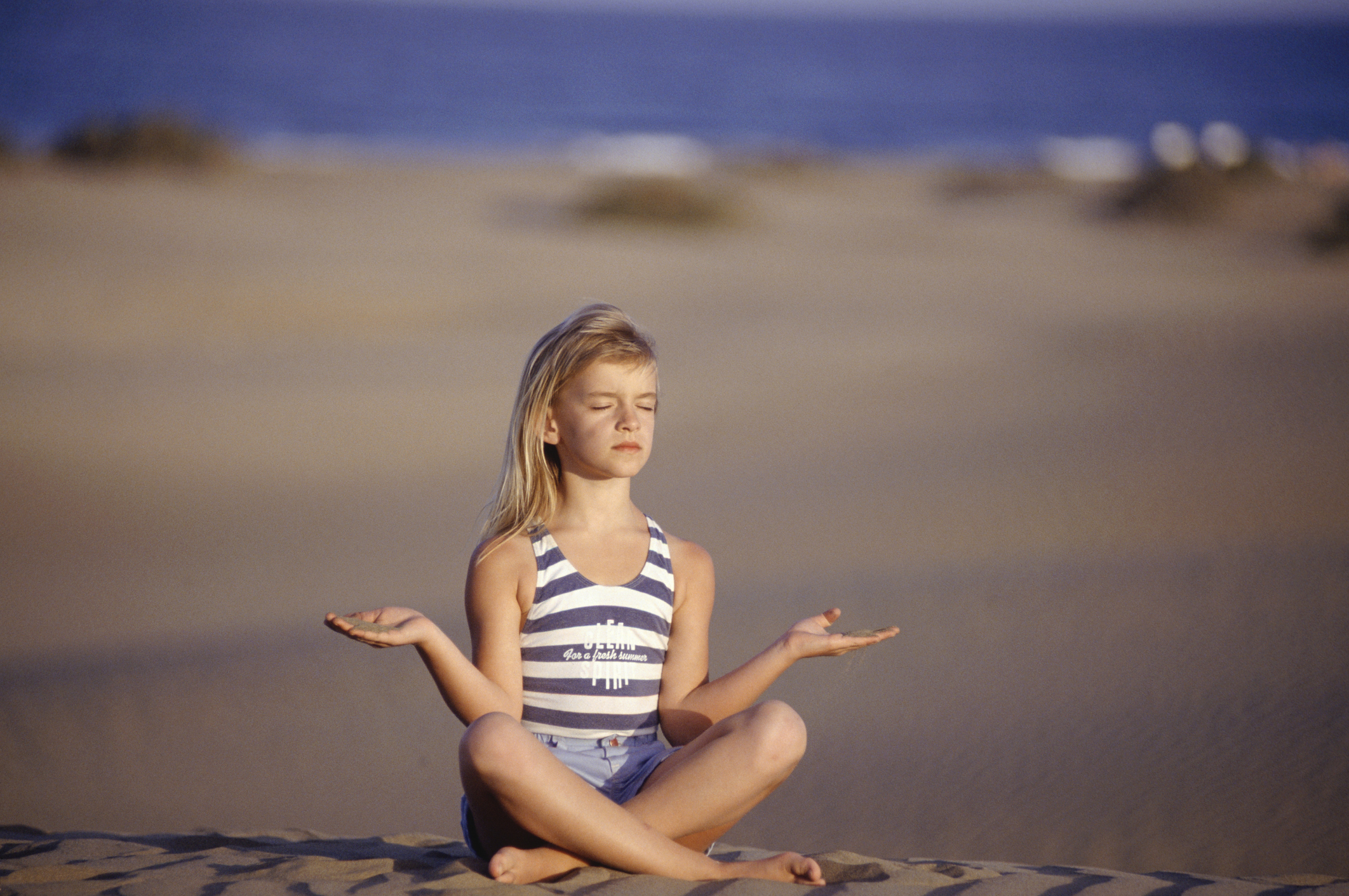 girl-doing-yoga-on-beachjpg