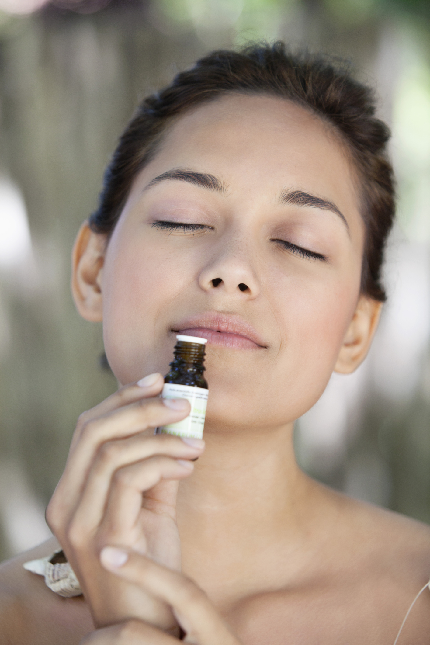 young-woman-smelling-aromatherapy-oiljpg